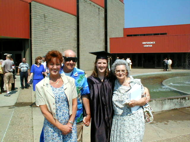The day Crissy graduated from Marshall University I was in Kenya so Kathy went in my stead, there's my Dad then Crissy and Mom there too.